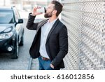 elegant businessman standing... | Shutterstock . vector #616012856