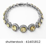 silver and diamonds bracelet with yellow topaz stone on white background - stock photo