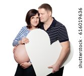 pregnant woman and her man... | Shutterstock . vector #616019636