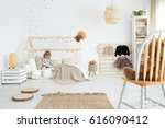 little girl sitting on her bed... | Shutterstock . vector #616090412