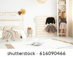 little girl playing in her... | Shutterstock . vector #616090466