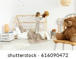 little girl in modern brown and ... | Shutterstock . vector #616090472
