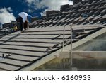 Roofer Laying Tile Shingles On...