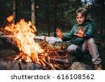 boy warms his hands near... | Shutterstock . vector #616108562