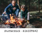 father and son roast the... | Shutterstock . vector #616109642