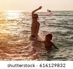 silhouette of two happy little... | Shutterstock . vector #616129832