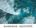 uluwatu cliff and blue ocean in ... | Shutterstock . vector #616131392