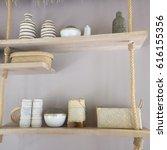 utensils hanging on wooden... | Shutterstock . vector #616155356