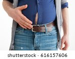 the man holds his hand over his ... | Shutterstock . vector #616157606