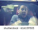 young man driving a car shocked ... | Shutterstock . vector #616159505