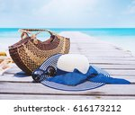 bag  straw hat  sun glasses on... | Shutterstock . vector #616173212