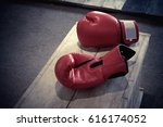boxing gloves on wood table | Shutterstock . vector #616174052