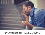 sorrowful crying young man... | Shutterstock . vector #616224242