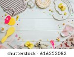 Stock photo baby accessories background baby jumpsuit socks soother and toys over white wooden background 616252082