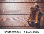 bottle of whiskey on wooden...   Shutterstock . vector #616281002