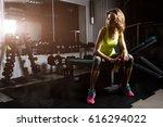 fitness girl blonde drinking... | Shutterstock . vector #616294022