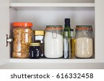 stocked kitchen pantry with... | Shutterstock . vector #616332458
