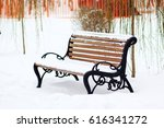Isolated Bench In The Park...