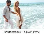 romantic couple on the beach   Shutterstock . vector #616341992