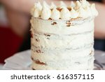 the naked cake being decorated