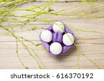 A Purple Egg Carton Lying On...