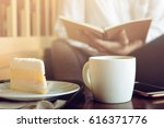 cup of cappuccino with dessert... | Shutterstock . vector #616371776