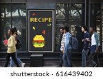 Small photo of People with advertisement of 8 bit illustration of tasty burger meal