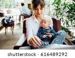 beautiful young mother working... | Shutterstock . vector #616489292
