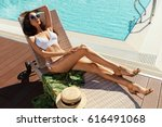 sexy woman in bikini sunbathing ... | Shutterstock . vector #616491068