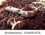 coffee beans and portafilter. | Shutterstock . vector #616491476