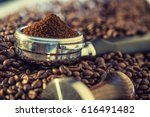 coffee beans and portafilter.  | Shutterstock . vector #616491482