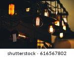 edison lamps on dark background ... | Shutterstock . vector #616567802