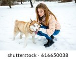 girl and dog are walking in the ... | Shutterstock . vector #616650038