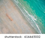 a line of camels waking along... | Shutterstock . vector #616665032