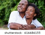 happy young couple embracing... | Shutterstock . vector #616686155