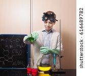 laboratory flasks with liquid... | Shutterstock . vector #616689782