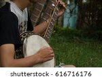 Young Man Sitting Banjo Happil...