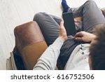 man using smartphone | Shutterstock . vector #616752506
