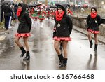 Small photo of STUTTGART, GERMANY - FEBRUARY 28: group of young nice majorettes marching notwithstanding the weather . Shot under rain at Carnival parade in city center on feb 28, 2017 Stuttgart, Germany