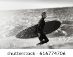 surfer silhouette of a man... | Shutterstock . vector #616774706