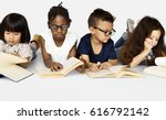Small photo of Diverse Group Of Kids Study Read Book