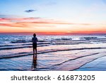 Woman Watching Sunset On The...