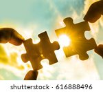 two hands trying to connect... | Shutterstock . vector #616888496