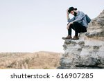 a man in a hat sitting on a... | Shutterstock . vector #616907285