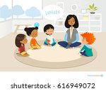 smiling kindergarten teacher... | Shutterstock . vector #616949072