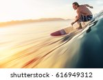 surfer rides the perfect ocean... | Shutterstock . vector #616949312