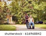 caring daughter and senior man... | Shutterstock . vector #616968842