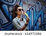 urban young woman posing... | Shutterstock . vector #616971386