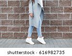 woman in white sneakers and... | Shutterstock . vector #616982735