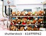 a mechanical arm selecting... | Shutterstock . vector #616998962
